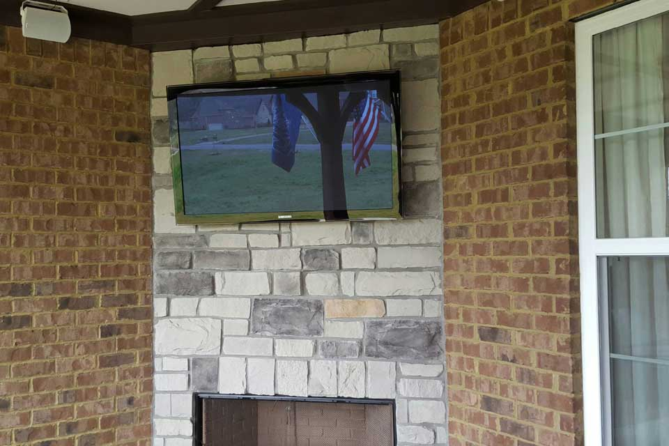 outdoor-tv-over-stone-fireplace